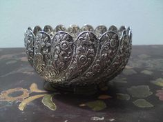19th century Burma / India hand beaten relief peacock feather flower silver bowl