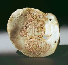 Maya. shell. ht approx 10cm. Early classic portrait of a ruler. One hand is visible in the lower register.