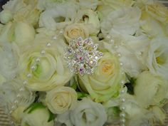 Beautiful vintage wedding flowers with sparkling brooches. Available from The Flower Academy Inc Ltd. www.thefloweracademy.org