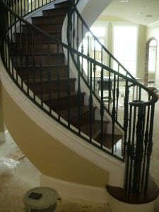 metal spindles on curved staircase