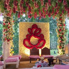Wedding mandap decorated with lilies roses and traditional flowers #InspiredWeddingDecor