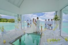 The luxurious Four Seasons' Landaa Giraavaru resort in the Maldives offers a pavilion raised on stilts that can only be reached by boat. Located off the tip of the island, the 485-square-foot(45m2) structure can seat 16 people, and features a glass aisle above a turtle enclosure. (20 yr vow renewal )
