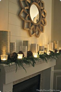 Lovely and simple Christmas mantle with greenery and candles. Get the same look, the safe and easy way, with Candle Impressions Programmable Timer Flameless Candles!