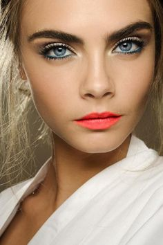 Blue eyeliner and bright coral lipstick