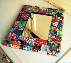 eclectic upcycled magazine decoupage framed mirror. via Etsy.