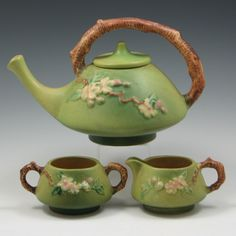 Roseville Apple Blossom Tea Set in green glaze. (Apple Blossom is a favorite pattern, along with a couple other flower patterns they used. This piece/set I love in all 3 colors, but usually green is my favorite ASW)