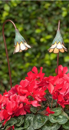 Our handmade Buttercup with Opal Glass Garden Light serves as elegant landscape art during the daytime, and functional garden lighting at night.