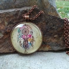 Check out this item in my Etsy shop https://www.etsy.com/listing/493515815/dream-catcher-glass-pendant-necklace
