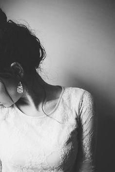 Black and white, shoulder detail, bun, earring