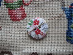 Never lose a needle again! This beautiful red floral needle minder is made with wooden buttons and strong magnets! The back magnet has a Needle Minders, Magnets, Strong, Unique Jewelry, Buttons, Handmade Gifts, Floral, Red, Etsy