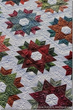 """Kathy's """"Daybreak"""" - with her own quilting - at Tamarack Shack"""