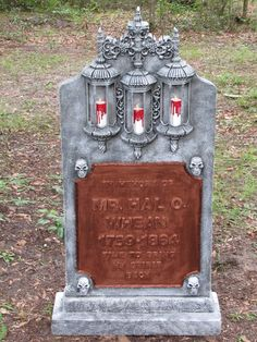 Tombstone idea. Make your own from styrofoam  glue on additional letters, flowers,etc. Paint to look realistic.