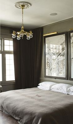 Bedroom, white pillows, grey cover, lamp, large windows, mirror