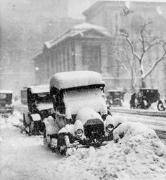 In 1917, the year that this photo was taken in New York City, automobiles were equipped with windshields but they did not yet have windows—you know, those pieces of glass above the doors of the car that keep stuff out. So snow removal was a back-breaking exterior and interior job.