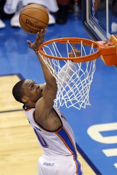 Oklahoma City's Russell Westbrook (0) shoots during Game 7 in the first round of the NBA playoffs between the Oklahoma City Thunder and the Memphis Grizzlies at Chesapeake Energy Arena in Oklahoma City, Saturday, May 3, 2014. Photo by Sarah Phipps, The Oklahoman