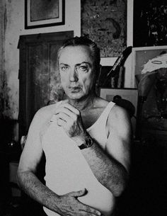 Udo Kier smoking a cigarette (or weed)