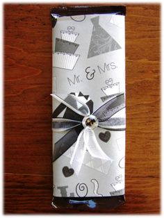 Easy wedding favor & so cute- plus so easy to personalize!! Take a hershey's candy bar or whatever kind you prefer and then wrap it with wrapping paper. Tie a bow on and put a thank you note!