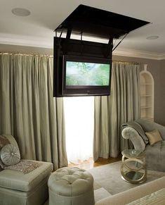 Secret Hatch Reveals Bedroom TV | Apartment Therapy