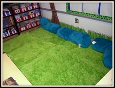 green grass rug and border along bottom of the wall