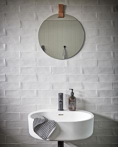 Powder room: hand basin, mirror with leather strap