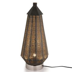 This stunning Fes lamp will add exotic glamour to any room.  Finished in black and coated in gold lacquer this lamp emits a soft warm glow.