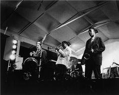 Uncredited Photographer     Miles Davis Sextet: Left to Right: Paul Chambers (bass), Cannonball Adderly (alto sax), Miles Davis (trumpet), Jimmy Cobb (drums), John Coltrane (tenor sax), Newport Jazz Festival, Newport, Rhode island     1958