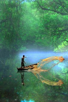 Casting a net. fishing, travel, jungle, tropics, river, canoe, indigenous, motion, boating, liana, tributary, work, man,