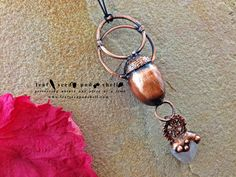 Here's a gorgeous acorn and tumbled rose quartz pendant in a rustic antique copper finish.  In store now. #leafseedpodshell #leafseedpodshelljewelry #birdhouse #leaves #leaf #acorn #acorns #seeds #pods #shells #copper #electroform #electroforming #electroformed #electroplated #electroplating #nature #natural #rustic #plating #jewelry #jewellery #pendant #pendants #handmade #handmadejewelry