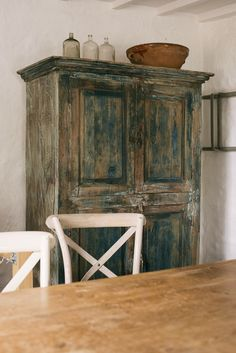in love with this distressed antique pantry cupboard