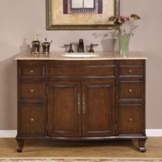 Bathroom single sink cabinet vanity Materials: Natural stone top, solid wood structure and CARB Ph2 certified plywood, MDF panels, ceramic sinkHardware finish: Antique brass