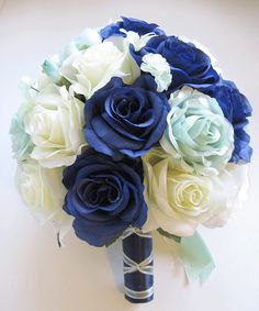 I would use real flowers instead of silk : a navy, mint green and cream coloured rose surrounded by baby's breath for the bridesmaids and a more elaborate bouquet for the bride would be beautiful but still wrapped in the navy material
