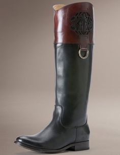 Frye Melissa Logo Black Multi. A blazing beauty, etched by lasers with our latest calligraphic double F. Contrasting panels on the shaft are an English tradition, reserved for riders of a certain station. A single D-ring, stamped with our name, bridges the gap. Shop for this and many more items at Emma Laura in Dublin, GA in Ivy Place Shopping Center. You can also purchase by phone at 478-272-2095 or shop our website at www.emmalaura.com.