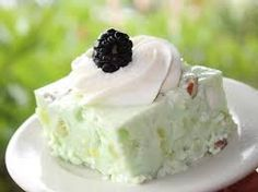 GREEN JELLO SALAD Luby's Cafeteria Copycat Recipe  2 (3-oz.) boxes lime Jello 1 (20-oz.) can crushed pineapple, 1 (16-oz.)  container of cottage cheese 1/4 cup pecans,crushed 1 (8-oz) container Cool Whip 2 cups boiling water 1 cup cold water  In large mixing bowl, prepare gelatin as package describes. To mixture, add drained crushed pineapple, cottage cheese, and whipped topping. Stir mixture until whipped topping is blended. Pour into a pan and sprinkle nuts on top, chill until set.