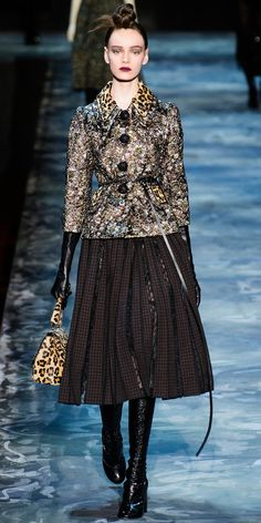 Marc Jacobs showed a more covered up look by pairing tall boots with a full midi skirt. No tights needed.