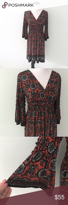 """MAX STUDIO Rust black Boho paisley Dress Boho dress with bell sleeves. V-neck. Length 36"""". Chest 17.5"""". Polyester and spandex. Rust colored dress with black paisley design. Max Studio Dresses Long Sleeve"""