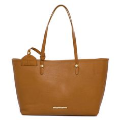The Strand Golden Tan Leather Tote Travel in complete glamour with the Strand Tote in tan. Designed around Elaine's love of travel, the Strand Tote in smooth tan leather offers a spacious interior for all your travel essentials. Toss in your luggage for later or carry it on the go!