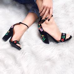 Chic ankle strap pumps with floral embroidery on a soft velour finish. So pretty!