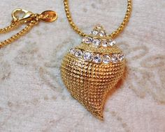 KJL Kenneth Jay Lane Crystal Seashell Brooch Necklace Chain Pendant is a versatile piece that can serve as a brooch or a necklace.