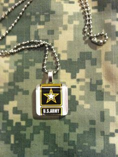 $10 Army symbol 7/8 inch glass tile necklace.