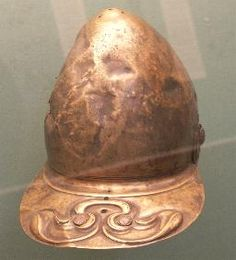 Brigantes Nation Celtic Iron Age Finds.  Helmet  AD 50-150  Possibly found in northern Britain    Copper alloy helmet with repoussé ornement on the neck guard.  Originally the cross-hatched studs were covered with opaque red glass.