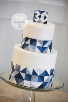 Geometric birthday cake based on a design by Poppy Pickering, which was based on the work of A K Cake Designs. Shades of blue and grey with silver leaf.
