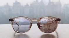 These are the glasses that john lennon was murdered in. they were left this way. Yoko ono decided she wanted to keep them, blood and all. I have always been a huge fan of the beatles, it angers me that he was murdered. I know he was not a perfect example of peace and love but still, he was a huge piece of history for me.