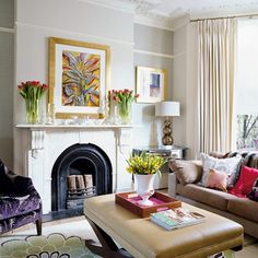 Plain room with touches of purple green and red that catch the eye