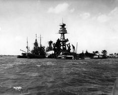 """""""USS Arizona (BB-39) sunk at Pearl Harbor, Hawaii, after her fires were out, 9 December 1941. She was destroyed during the Japanese raid of 7 December 1941. USS Navajo (AT-64) and USS Tern (AM-31) are alongside, spraying water to cool her burned out..."""
