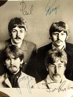 The Beatles.  Someone found this originally signed photo in the trash.