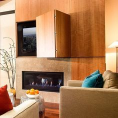 fire places hidden TV, wood panels-Cool concept but a TV should NEVER be put above a fireplace. It voids all warranties for the TV and the heat will basically destroy the TV. I do like the hidden TV concept. Modern Tv Cabinet, Tv Cabinet Design, Tv Wall Design, Living Room Tv, Living Room With Fireplace, Hide Tv Over Fireplace, Wood Fireplace, Tv Escondida, Hidden Tv Cabinet