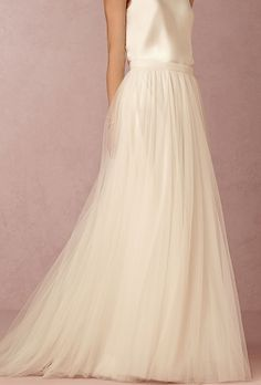 Brides: BHLDN. See more details about this dress from BHLDN  Celestial layers of ivory tulle form a graceful, airy layered skirt perfect for pairing with both slim gowns and corsets. Also available in Porcelain and Grey.