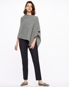 Woven from 100% merino wool, this poncho features ottoman rib detailing. Soft to…