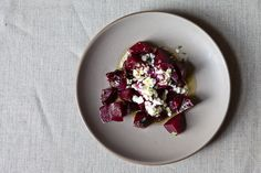 SERVES 4 AS A SIDE DISH    For the smoked beets:    8 small beets, with greens if possible  1 small bunch fresh rosemary  For the salad:    1 tablespoon red wine vinegar  Extra virgin olive oil  Sea salt and freshly ground black pepper  1 small bunch fresh flat-leaf parsley, leaves picked and roughly chopped  1 small bunch fresh tarragon or basil, leaves picked and roughly chopped  4 heaped tablespoons cottage cheese  juice and zest from 1/2 lemon, plus more to taste  A few sprigs of fresh t...