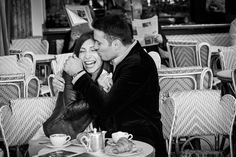 Couple celebrating love in Parisian café.  www.theparisphotographer.com